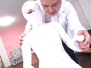 Subtitled Japanese woman bandaged head to toe